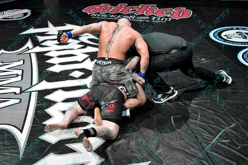 During the 2nd match of the Mixed Martial Arts match between CURTIS ELLER (blue tape) and RYAN WALKER (red tape) at the Fight Hard MMA held at the Family Arena in St. Charles MO.