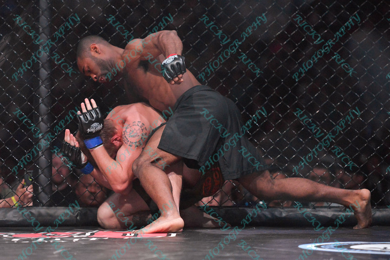 during the 8th fight of the Mixed Martial Arts match between CODY HUFF (blue tape) and DEREK CLARDY (red tape) at the Fight Hard MMA held at the Family Arena in St. Charles MO. where DEREK CLARDY defeated CODY HUFF