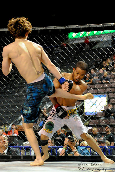 Joe Szczublewski kicks Cortez Phelia during the American MMA Ohio Championships at US Bank Arena in Cincinnati,Ohio. during the American MMA Ohio Championships at US Bank Arena in Cincinnati,Ohio.