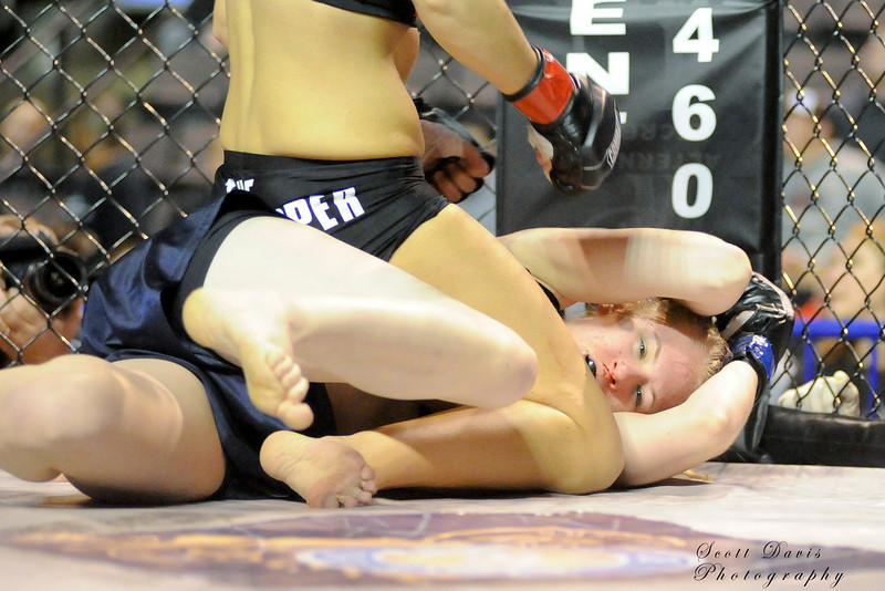 Rita Myers (bottom) tries to cover up during the American MMA Ohio Championships at US Bank Arena in Cincinnati,Ohio. during the American MMA Ohio Championships at US Bank Arena in Cincinnati,Ohio.