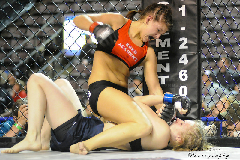 Lisa Reed (top) pounds Rita Myers during the American MMA Ohio Championships at US Bank Arena in Cincinnati,Ohio. during the American MMA Ohio Championships at US Bank Arena in Cincinnati,Ohio.