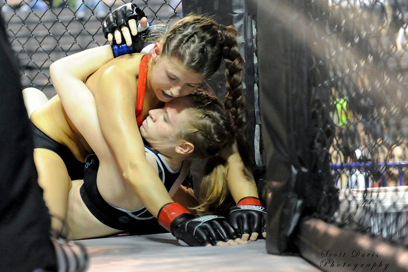 Lisa Reed on top of Rita Myers during the American MMA Ohio Championships at US Bank Arena in Cincinnati,Ohio. during the American MMA Ohio Championships at US Bank Arena in Cincinnati,Ohio.