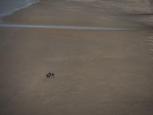 Walkers on Rhossili Beach