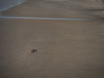 Walkers on Rhossili Beach