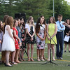 the eighth grade chorus sings the Star Spangled Banner.