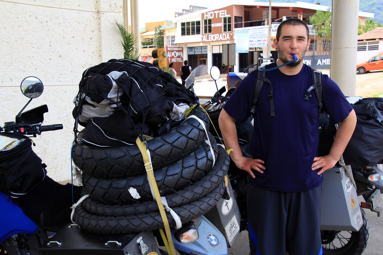 """We're about to enter Guatemala in this shot so we took off our riding gear to stay comfortable during the border crossing. Usually we have on our mesh riding jacket and pants. We were told that entering Guatemala would take whopping four hours with many fixers trying to """"help us"""" but we managed to get through in a quick two hours. -Conor"""