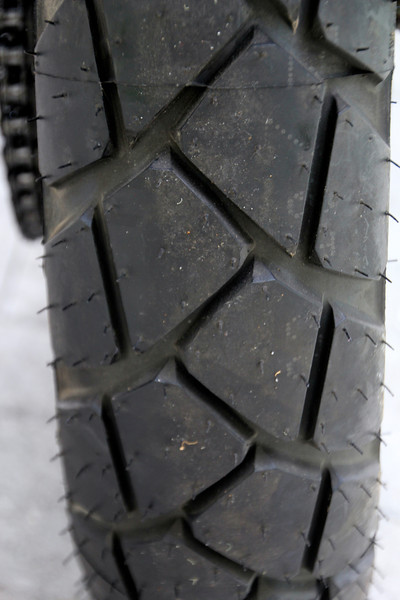 """NEW TIRES!!! These are top of the line and will finish out the trip for us. We will ride safer once these are """"broken in"""" and the oils wear off.  -Conor"""