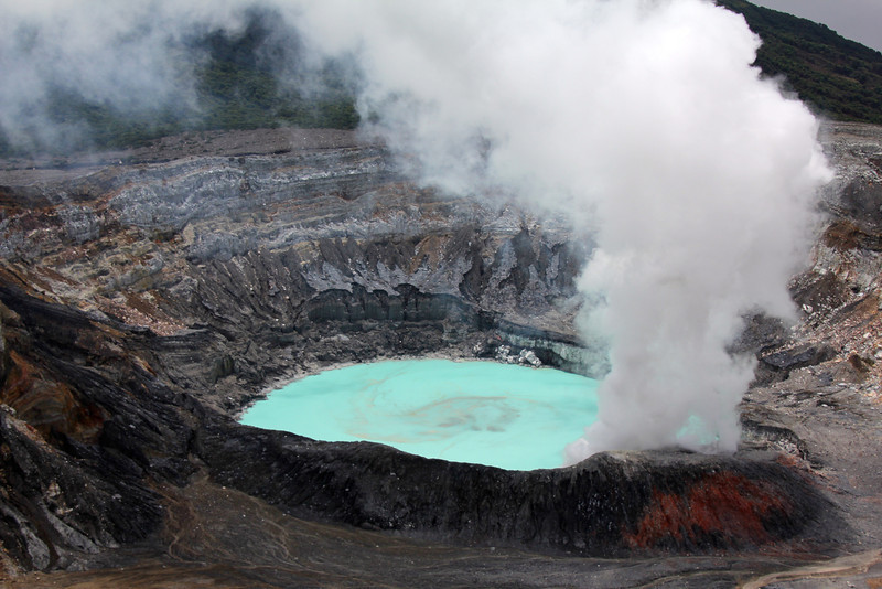 This crater is quite active with frequent small geyser and lava eruptions, however the last major eruptions were during 1952-54. The sulfuric acid you see in this photo has temps over 1,000 degrees C. Rainfall with actually evaporate before it reaches the crater. - Jay