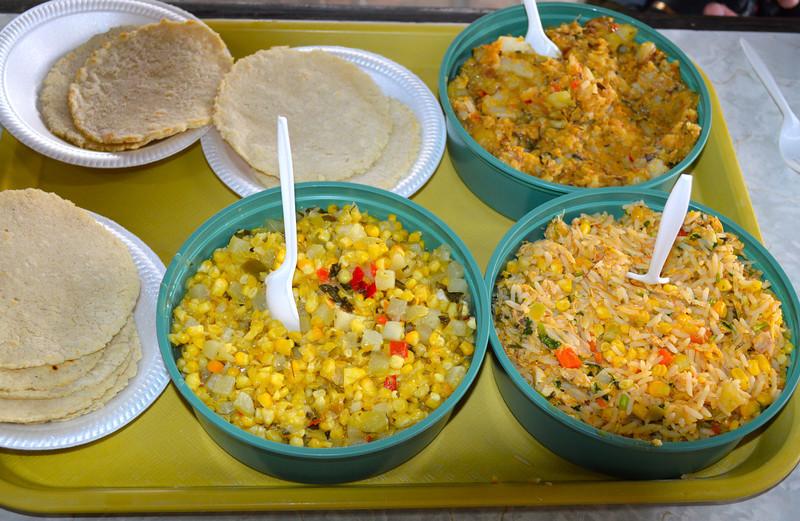 Three amazing dishes - guiso de maiz (left), arroz con pollo (right), picadillo de papa (top). This comida tradicionales was so good! - Jay