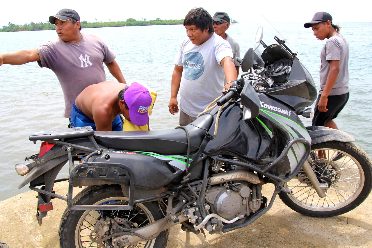 A couple Kuna (natives to the islands by Panama) guys helped us with loading the bikes on the boat. - Conor