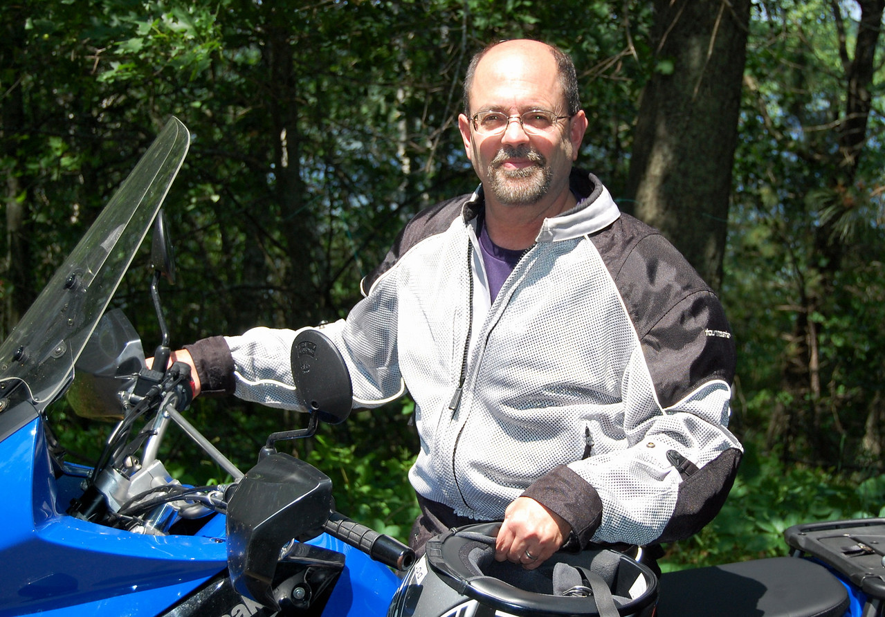 """I'm Jay Rasmussen, the patriarch of this father/son moto team. I'm currently a professor of education at Bethel University in St. Paul, MN. When not planning lessons, grading papers, and generally making life miserable for my students I love to travel and have adventures. Fortunately, I'm married to a fellow adventurer (Roberta) and my daughter (Nina) is bitten by the same bug. As a family we've lived in Norway, traveled Europe with one 22"""" rolling suitcase per person, and built a small casita in Manzanillo, Mexico. -Jay"""