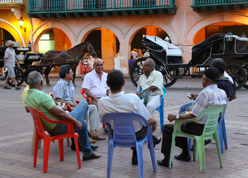 Every night these gentleman would gather for a VERY spirited and animated discussion about varied topics; traditional horse drawn carriages are visible in the background. - Jay