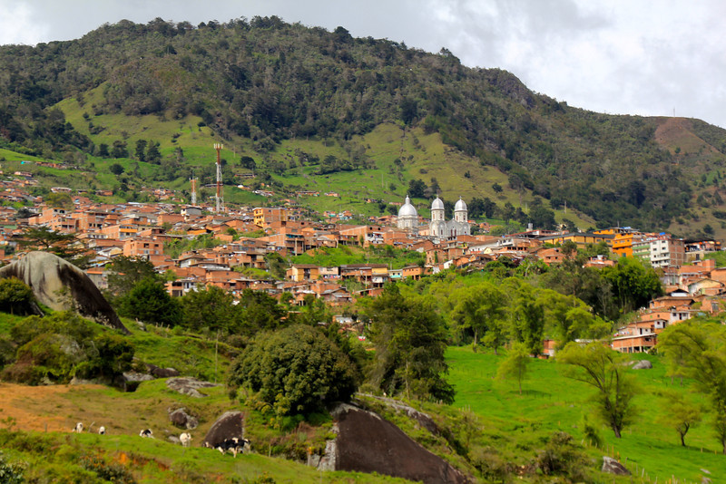 We passed by this town as we neared Medellin - notice the holsteins (dairy cattle) in the foreground. - Jay