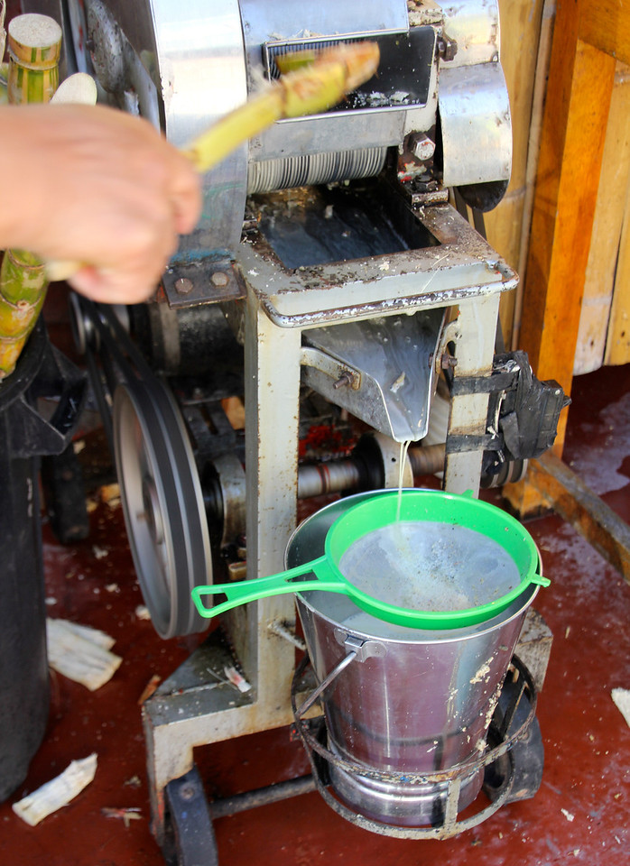 Grinding out the cane juice. In Colombia we'd see/try to pass trucks pulling up to six trailers packed with cane. They call this a tren (train). - Jay