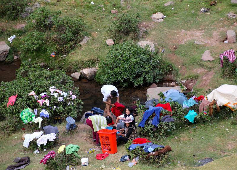 As we headed to Ollantaytambo (about an hour from Cusco) we passed about 100 people congregated by the river. Naturally, we had to stop and then figured out  this was a Sunday clothes washing/visiting routine. Notice the gender roll differences displayed between this photo and the next. - Jay