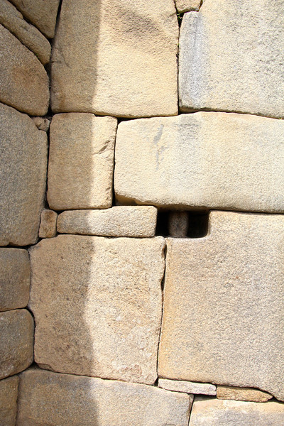 """L""-shaped blocks often were used to tie outside corners of the structure together.<br /> <br /> How they moved and placed the enormous blocks of stones remains a mystery, although the general belief is that they used hundreds of men to push the stones up inclined planes. - Jay"