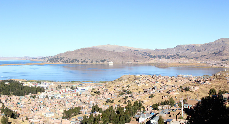 This is a shot of Puno which is located on the famous Lake Titicaca. The lake itself borders on both Peru and Bolivia and is largest in all of South America (you just see a fraction of it here). It is also considered the highest navigable lake in the world, with a surface elevation of about  12,500 ft.- Jay