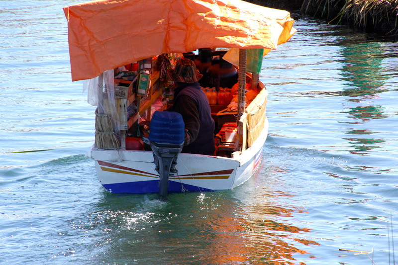 These boats would occasionally visit the islands to sell products to the Uros (Coke, rice, etc.). - Jay