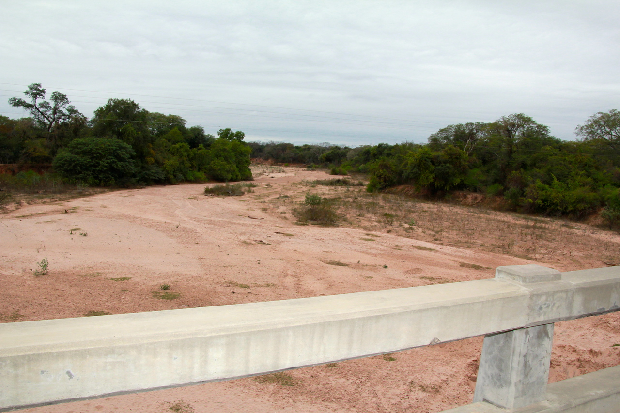 This is what we call a sand river during the dry season. There were about four or five bridges we crossed  in Bolivia that went for a long distance with only sand underneath. We were both shocked at the first one we saw.- Conor