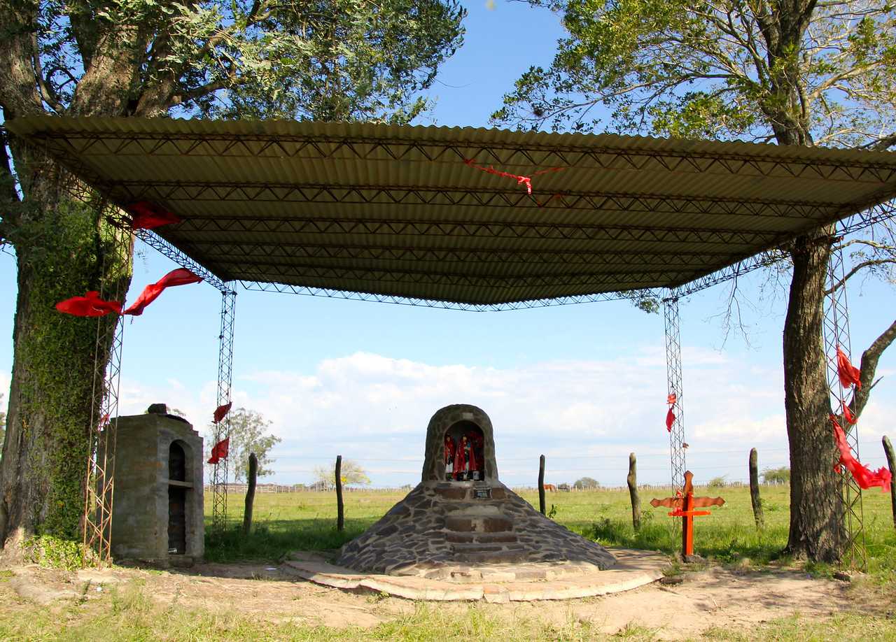 As we rode through much of northern Argentina we'd often see shrines such as this one. There were always red ribbons/fabric in the trees and we're still puzzled about the meaning of all this. - Jay