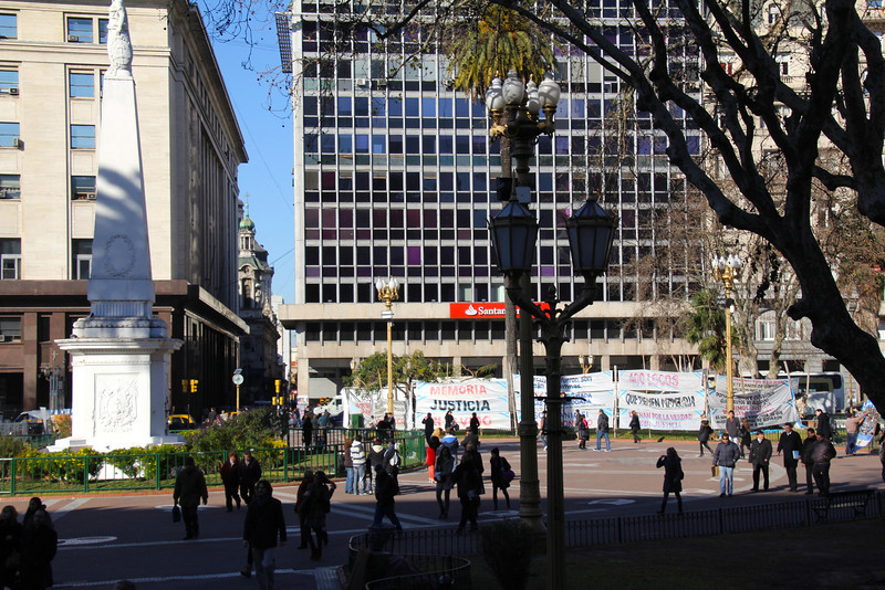 On Day 66 we took a yellow bus tour of BA. Pictured here is the famous Plaza de Mayo, site of the first monument in the city and various protests. <br /> <br /> In the late 70s this was the site of the silent marches of the Mothers of the Plaza de Mayo who were demanding justice for the 30,000 desaparecidos (people kidnapped and killed by the military during the years of the junta). - Jay