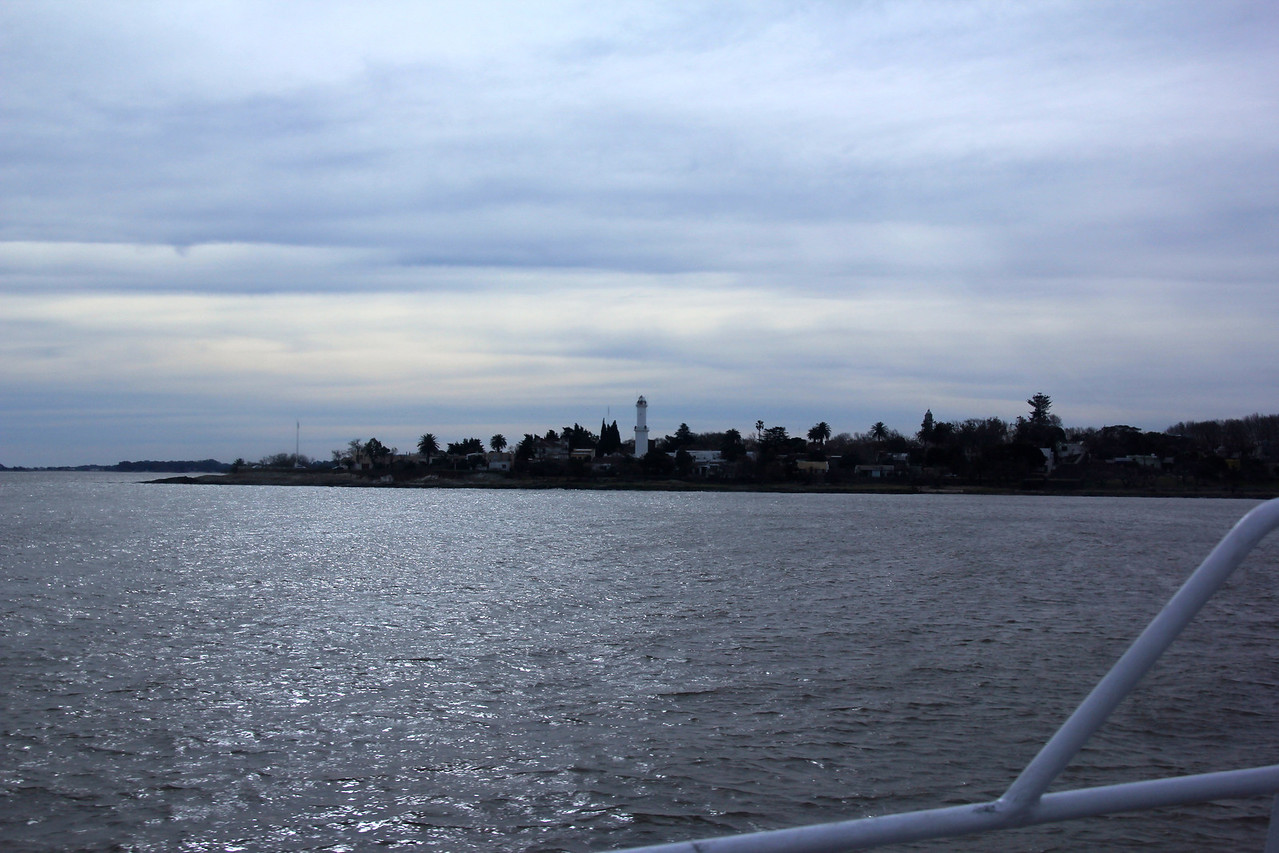 Approaching Colonia and El Faro (the light house) is visible.  Colonia was first settled by the Portuguese in 1680 and it now serves as a popular tourist destination for residents of BA and other parts of South America. - Jay