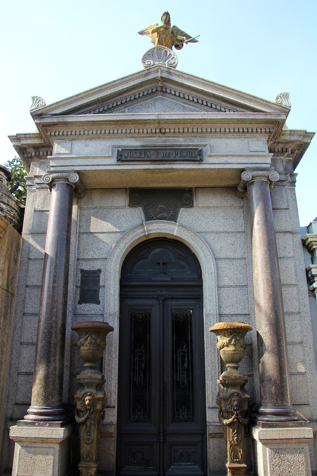 The cemetery contains many elaborate marble mausoleums, decorated with statues.  - Jay