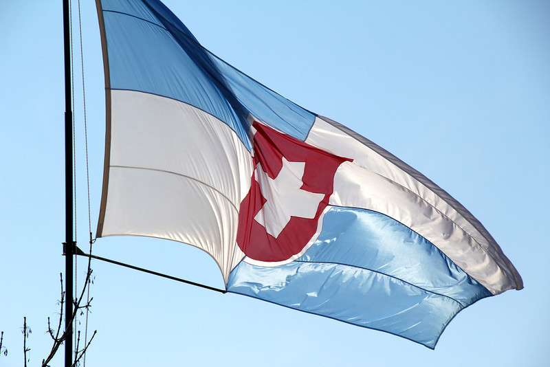 An interesting flag flies in town (Uruguayan and Swiss colors). - Jay