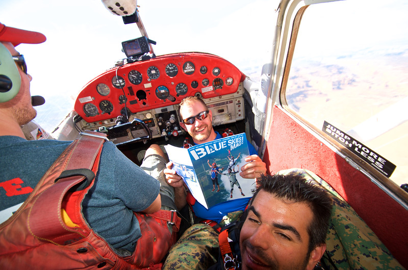 Reading a copy of Blue Skies Mag in the Plane