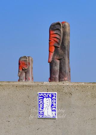 April 17th 2019.  Elephant man urban art on the river wall near the arsenal pier