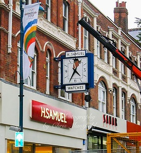 August 2012 ..  The iconic clock on H Samuel is being removed and dumped
