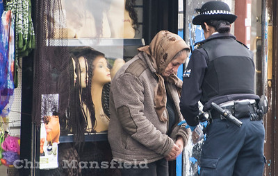 Jan' 25th 2017.  A female police officer speaks to a woman suspected of begging on Woolwich new road .
