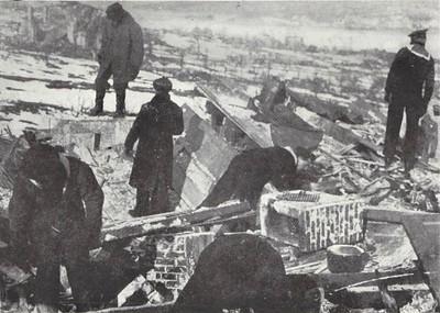 British sailors search the ruins for survivors or, more likely, dead bodies. Note the view beyond these searchers - total devastation.