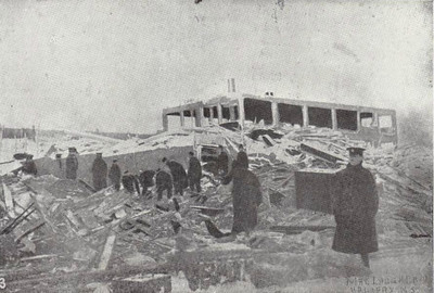Searching for survivors amid the wreckage of Richmond. Even the concrete buidling in the background has been totally destroyed.