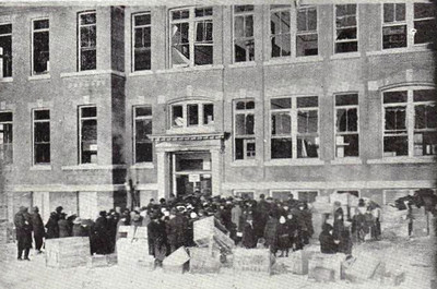 Crowds of people swarming into Chebucto Road School to identlify the dead. There was much uncertainty regarding casualties at first as the explosion, occuring at 9.05am, had caught many people out and about on their usual business and many children has stopped to watch the drama on their way to school. Note that the school itself, a substantial building, is in less than pristine condition.