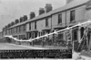 APRIL 25TH, 1916 - LOWESTOFT - This row of terraced houses in Kent Road is about a mile inland, north of the Docks. Presumably, brick-built low-quality housing offered little resistance to naval ordnance designed to penetrate armoured steel. How this shell could travel through 13 houses and injure no one is truly remarkable.
