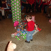 RYDER, ANGIE/AUSTIN'S NEPHEW, GETS THE FIRST GIFT.