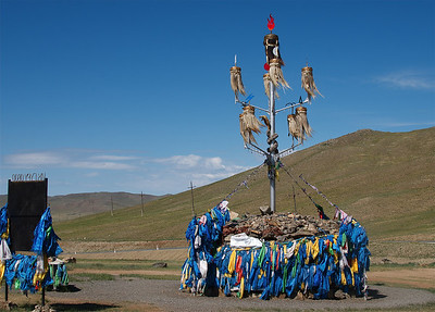 An ovoo (Mongolian: овоо, heap) is a type of shamanistic cairn found in Mongolia, usually made from rocks or from wood. Ovoos are often found at the top of mountains and in high places, like mountain passes. They serve mainly as religious sites, used in worship of the mountains and the sky as well as in Buddhist ceremonies, but often are also landmarks. The Mongolian country side scenery is dotted with all sorts interesting Ovoos.