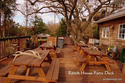 This expansive wrap-around party deck off the main Ranch House boasts one of the best views of The Ranch overlooking the Main Lawn, The Lake & the owner's Sculpture Garden. This stunning outdoor party deck is outfitted with oversized seating areas and picnic tables, professional grade outdoor grill/bbq facilities, oversized full bar, handsomely decorated outdoor bathroom & shower, & large trough style ice & beverage containers.