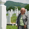Dr. Minka Cehajic. Retired pediatrician Dr. Minka Cehajic at the grave of her husband, Muhamed Cehajic, in Sanski Most in the summer of 2007.  Muhamed Cehajic was the legally elected mayor at the time of the Serb takeover of Prijedor's government; he was killed in Omarska in 1992.  Photograph by Patrick McCarthy.