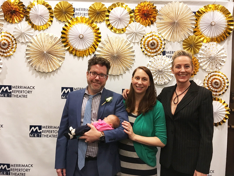 MRT Artistic Director Sean Daniels of Lowell, holding his precious daughter, newly born Vivien Adventure, and wife, Veronika Duerr, with mistress of ceremonies and auctioneer Julia Brothers of New York City