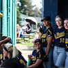 Mt. Pleasant's Maggie Zurawski (8), Erica Lybeer (11), Hannah Carson (10) and Katie Heller (14) pose for a photo in the dugout as they play Carman-Ainsworth at Mt. Pleasant Monday, April 18, 2016.  (PHOTOS BY KEN KADWELL -- FOR MIPREPZONE.COM).