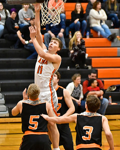 Alma used a strong third quarter to break open a tight conference game against Chesaning in a boys and girls doubleheader at home Tuesday, Feb. 20, 2018. (Sun photo gallery by Skip Traynor)