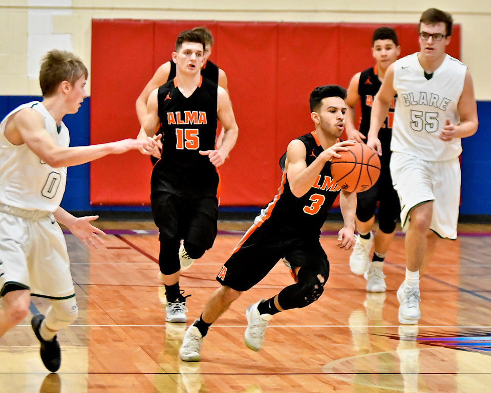 . Alma claimed the district crown with a hard-fought win over Clare 66-56 at Chippewa Hills Friday, March 9, 2018. (Sun photo gallery by Skip Traynor)