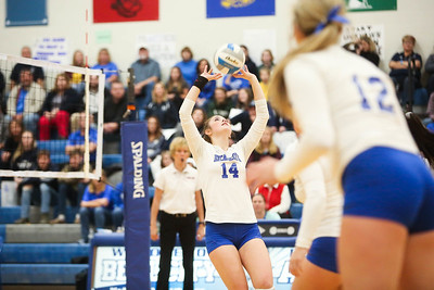 Beal City's Bailey Torpey (14) sets the ball against Hemlock in a series for the District Title Friday, Nov. 2, 2018. Beal City advanced after sweeping Hemlock in three games.  (PHOTOS BY KEN KADWELL--FOR MORNINGSUN.COM).