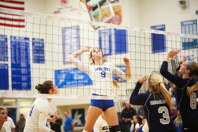 Beal City's Macy Vondoloski (8) goes up for a kill against Hemlock in a series for the District Title Friday, Nov. 2, 2018. Beal City advanced after sweeping Hemlock in three games.  (PHOTOS BY KEN KADWELL--FOR MORNINGSUN.COM).