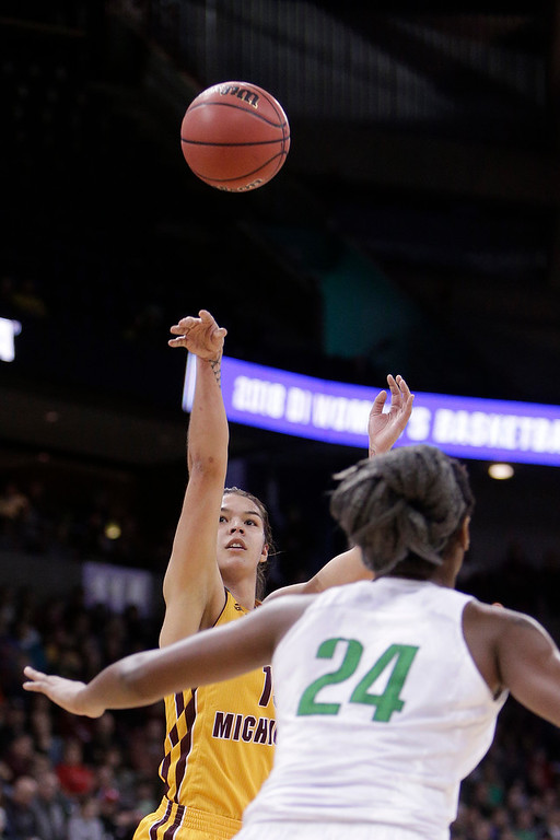 . Central Michigan forward Reyna Frost, left, shoots in front of Oregon forward Ruthy Hebard, right, during the first half in a regional semifinal at the NCAA women\'s college basketball tournament, Saturday, March 24, 2018, Spokane, Wash. (AP Photo/Young Kwak)