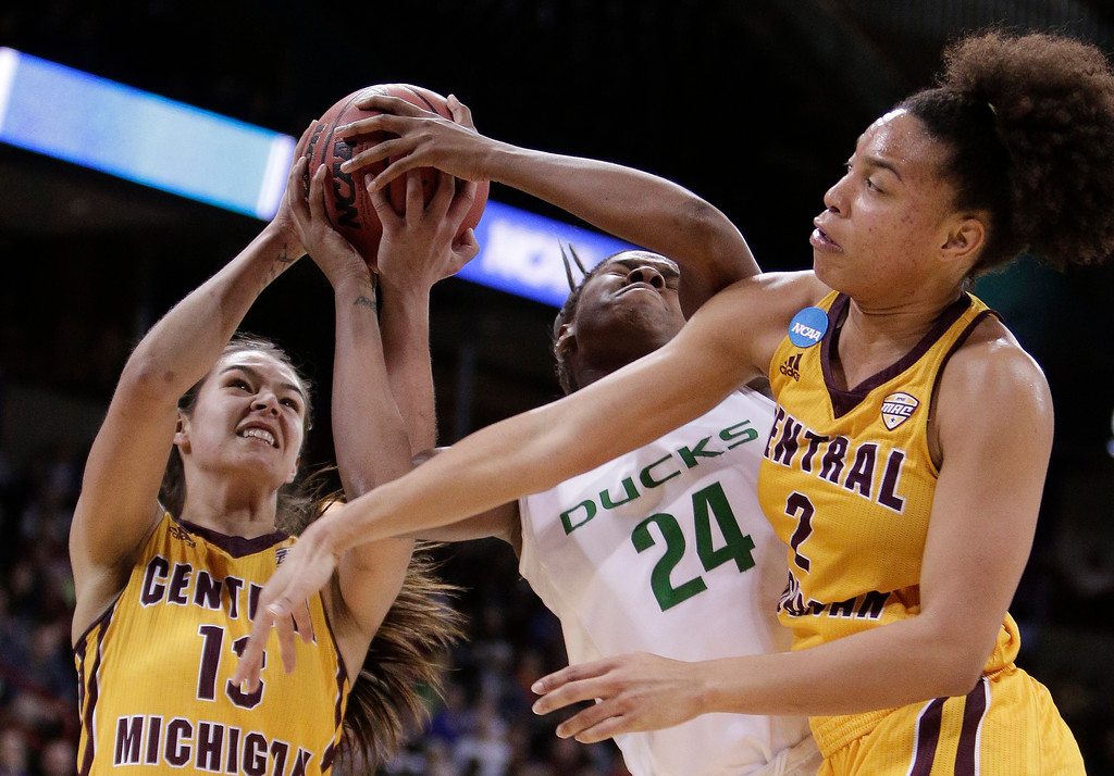 . Central Michigan forward Reyna Frost, left, ties up Oregon forward Ruthy Hebard, center, next to Central Michigan forward Tinara Moore, right, during the second half in a regional semifinal at the NCAA women\'s college basketball tournament, Saturday, March 24, 2018, Spokane, Wash. Oregon won 83-69. (AP Photo/Young Kwak)