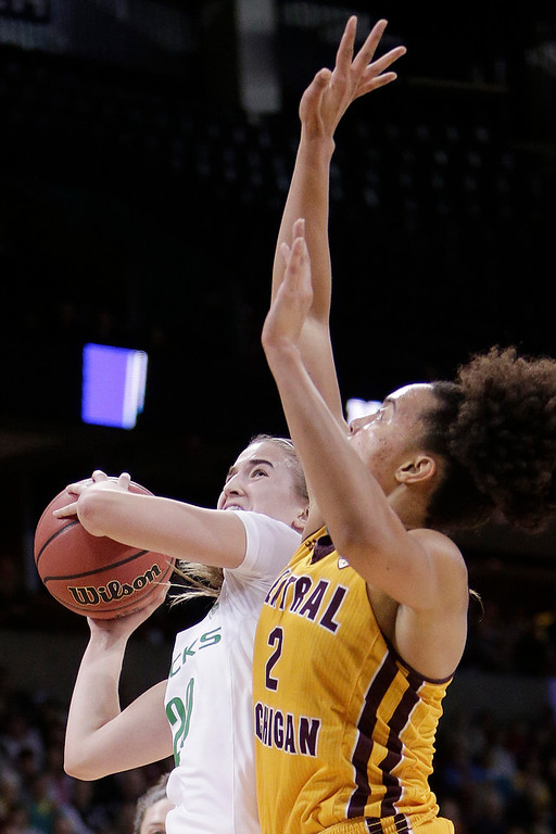 . Oregon guard Sabrina Ionescu, left, is fouled as she drives to the basket by Central Michigan forward Tinara Moore (2) during the second half in a regional semifinal at the NCAA women\'s college basketball tournament, Saturday, March 24, 2018, Spokane, Wash. Oregon won 83-69. (AP Photo/Young Kwak)