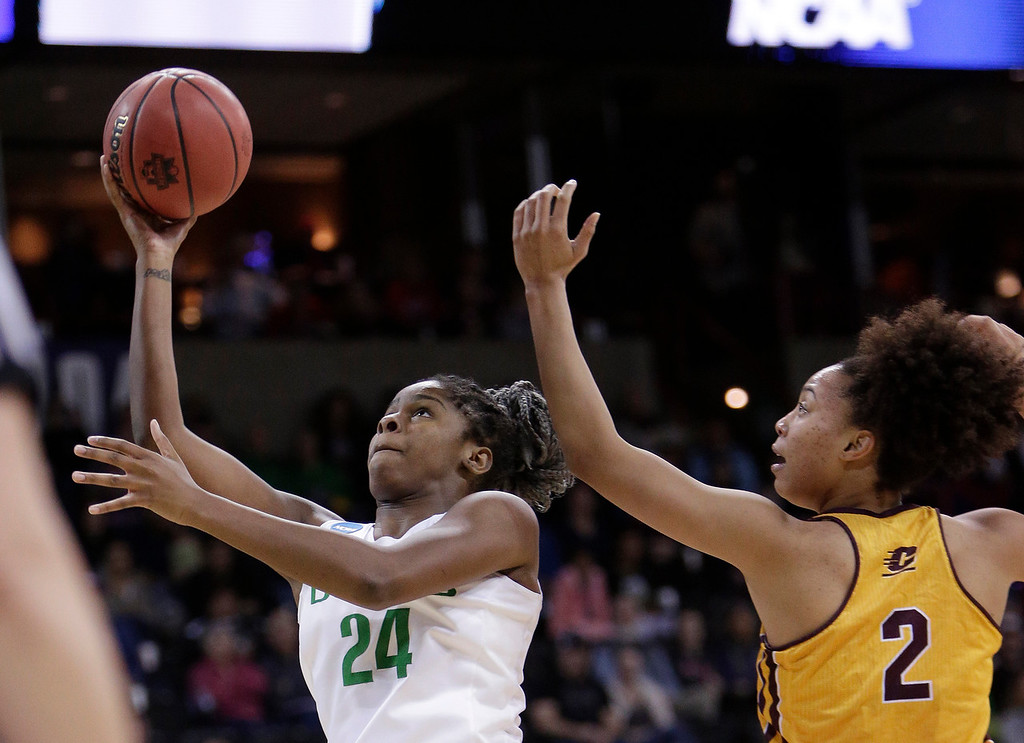. Oregon forward Ruthy Hebard (24) shoots in front of Central Michigan forward Tinara Moore (2) during the first half in a regional semifinal at the NCAA women\'s college basketball tournament, Saturday, March 24, 2018, Spokane, Wash. (AP Photo/Young Kwak)
